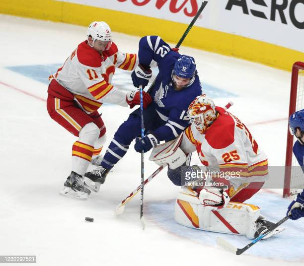 April 13 In second period action, Toronto Maple Leafs center Alex Galchenyuk gets shoved into Calgary Flames goaltender Jacob Markstrom by Mikael...