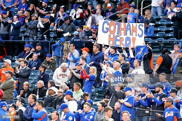 Fans cheer on New York Mets Starting pitcher Matt Harvey [8336] as he walks from the bullpen to the dugout prior to the game between the Philadelphia...