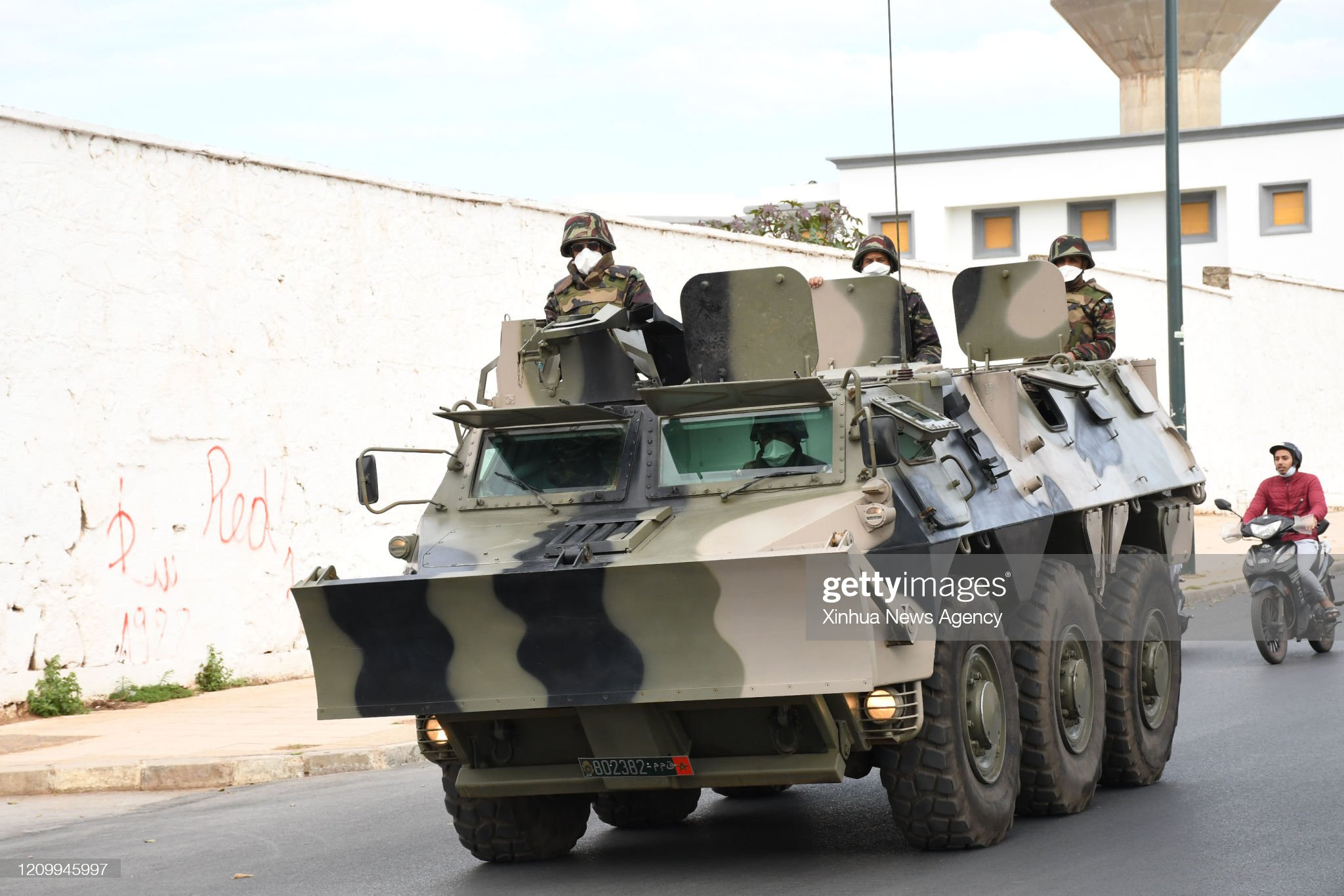 Renault VAB VTT et VCI des Forces Armées Royales - Page 3 April-14-2020-soldiers-wearing-masks-are-seen-on-a-military-vehicle-picture-id1209945997?s=2048x2048