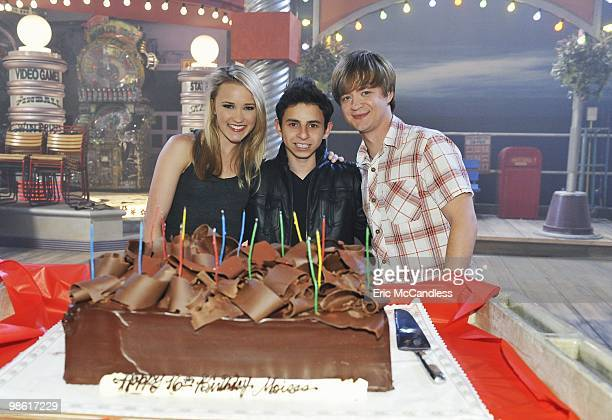 """April 15, 2010 - The cast and crew of Disney Channel's hit series """"Hannah Montana"""" celebrate Moises Arias' 16th birthday on set. EMILY OSMENT, MOISES..."""