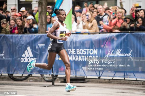 April 15 2019 Worknesh Degefa of Ethipoa approaches the finish line where she wins the 123rd running of the Boston Marathon on Monday April 15 2019