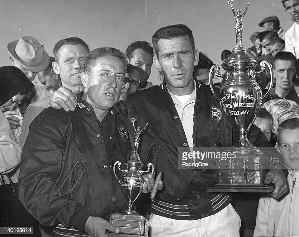 Driver Rex White and his crew chief Lewis Clements hold their trophies in victory lane at North Wilkesboro Speedway after White won the first Gwyn...