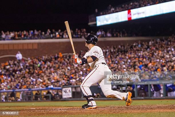 San Francisco Giants catcher Buster Posey watches the trajectory after he gets a hit in the 8th inning during the game between the San Francisco...