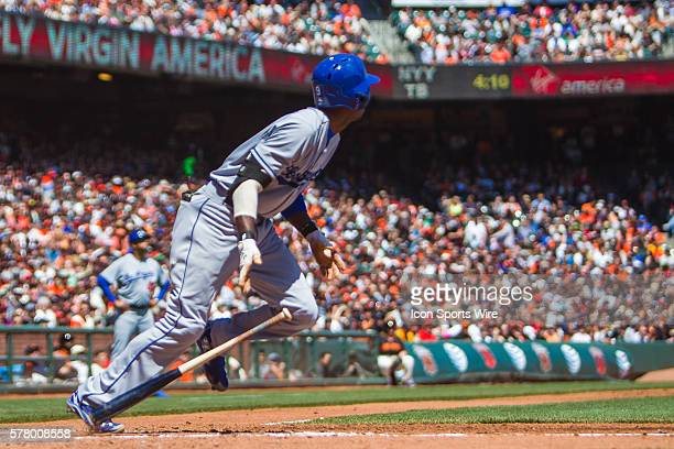 Los Angeles Dodgers second baseman Dee Gordon watches the trajectory of the ball after he hit a single during the game between the San Francisco...