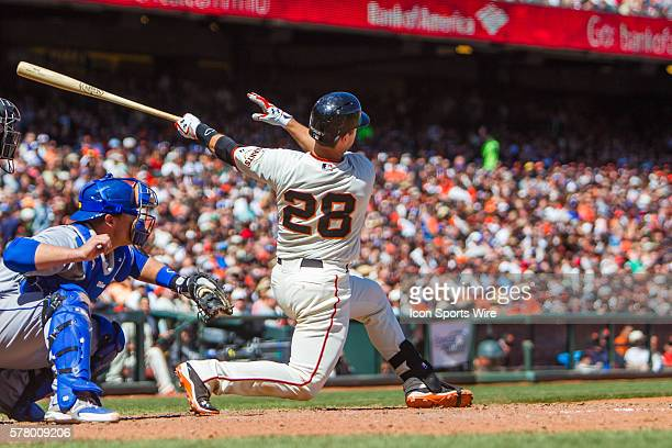 San Francisco Giants catcher Buster Posey watches the trajectory of the ball after connecting during the game between the San Francisco Giants and...