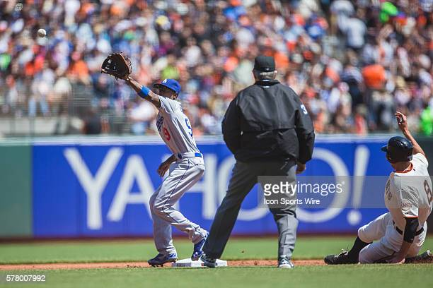San Francisco Giants right fielder Hunter Pence slides into second base as Los Angeles Dodgers second baseman Dee Gordon reaches for the ball during...