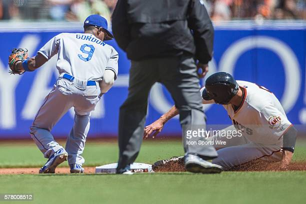 San Francisco Giants right fielder Hunter Pence slides into second base as Los Angeles Dodgers second baseman Dee Gordon reaches for the ball and...