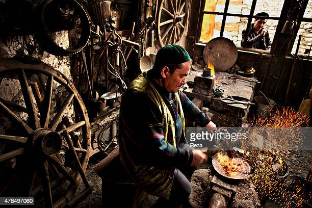 April 17 Lahij Ismailli District Shirvan Azerbaijan In his shop a coppersmith heats and pounds copper to make a plate Lahij is the old center of...
