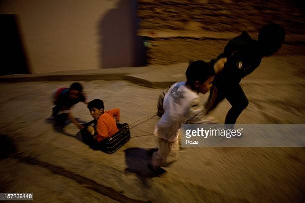 April 17th Town of Kristel Algeria At nightfall the children of the village of Kristel turn a crate into a cartoy