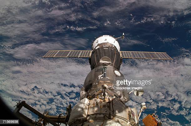 'April 18, 2005 - A blanket of clouds provides the backdrop for this scene of the Soyuz TMA-6 spacecraft, docked to the Pirs Docking Compartment on the International Space Station (ISS). '