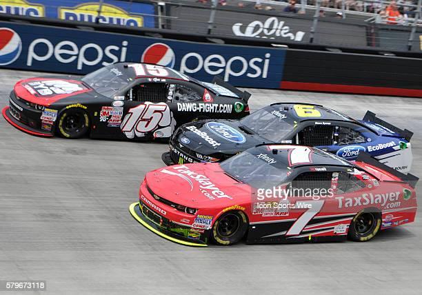 Regan Smith JR Motorsports Tax Slayercom Chevrolet Camaro and Chris Buescher Roush Fenway Racing Roush Performance Parts Ford Mustang race side by...