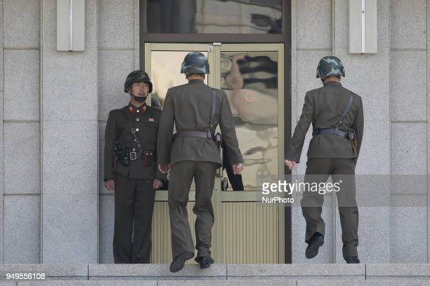 April 18 2018Pamunjom South KoreaNorth Korean security guard stand watch to south area visitors before the military demarcation line during a press...