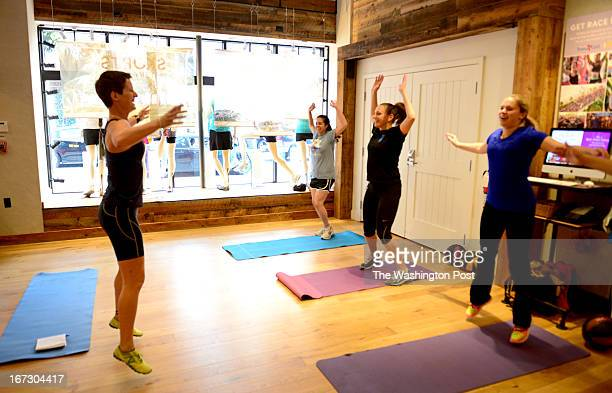 Fitness instructor Grace Thompson leads a class of students Catherine Potter Emerald Becker and Suzy Goldenkranz during a workout class held on the...