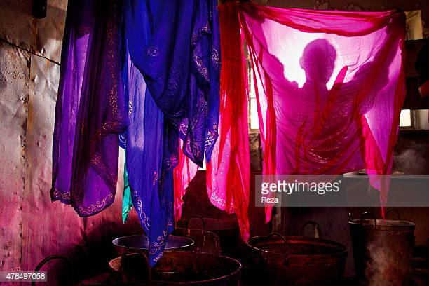 April 18 Silk Factory Sheki Azerbaijan A worker in the silk factory hangs newly dyed silk cloths to dry All of the dyes are made from natural sources...