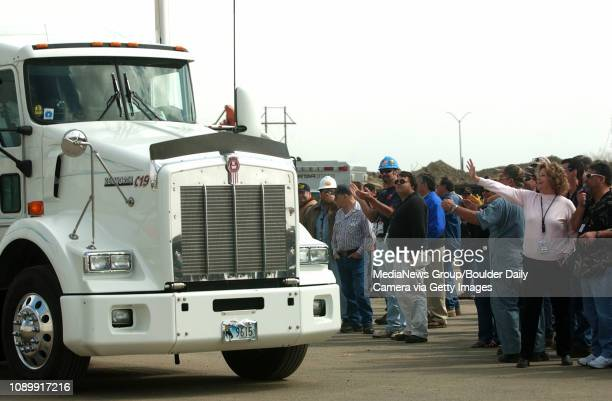 April 19, 2005 / Jefferson County Colo / Workers at Rocky Flats wave as a truck carrying the last of the sites transuranic waste leaves Rocky Flat in...