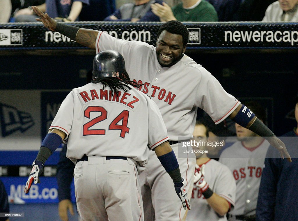 The Boston Red Sox defeated The Toronto Blue Jays 5-3 at the Rogers Centre Thursday afternoon after rallying to tie it at 3 on a 2 run Manny Ramirez Home Run in the top of the eighth inning. David Ortiz greets Ramirez at the Duggout after his HR. (DAVID COOPER / TORONTO STAR)dac