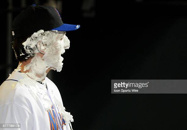 New York Mets first baseman Ike Davis laughs after getting a shaving cream pie to face courtesy of teammate Jeff Francoeur after making his major...