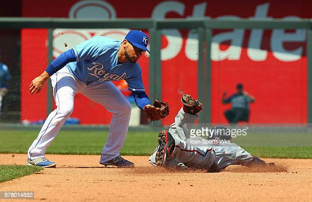 Minnesota Twins Pedro Florimon manages to slide safely into second despite an ontime throw to Kansas City's Omar Infante in the game between the...