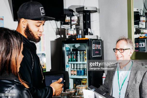 Bruce Nassau talks with customers in one of the five Tru Cannabis marijuana dispensaries that he owns in Denver Colorado on April 19 2015 In late...
