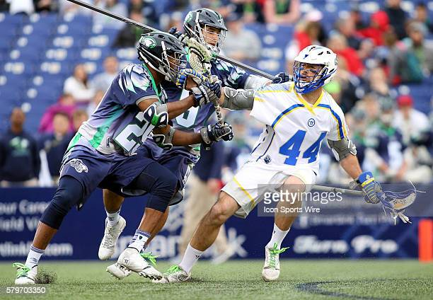 Chesapeake Bayhawks midfielder Mark McNeill and Chesapeake Bayhawks defender CJ Costabile in action against Florida Launch midfielder Steven Brooks...