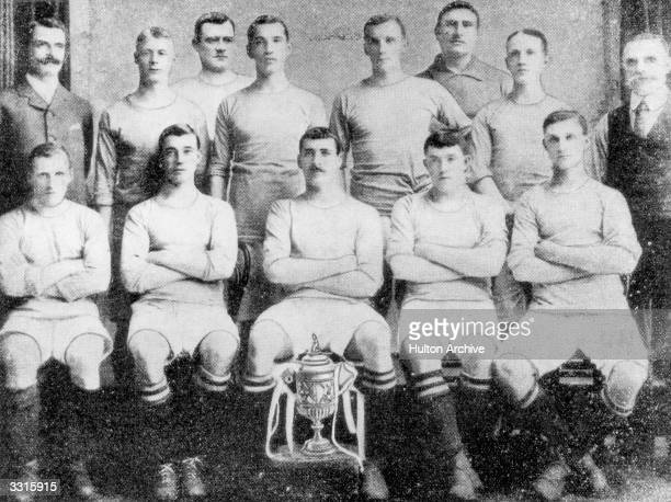 The Manchester City team line up with the FA Cup trophy that they won with a 10 victory over Bolton Wanderers at Crystal Palace From the back row and...