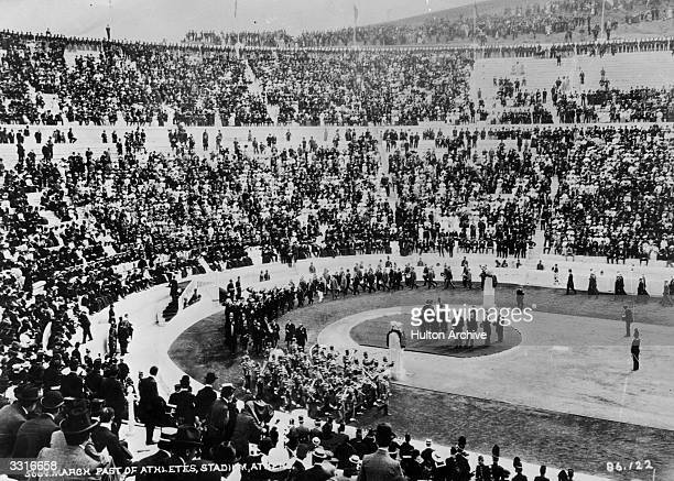 Competitors march past the crowds at the Olympic Stadium in Athens for the Opening Ceremony of the unofficial 'Intercalated' Olympics of 1906.