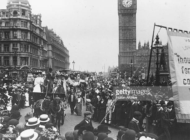 Suffragette prisoners pass the Houses of Parliament in London after their release from Holloway Prison