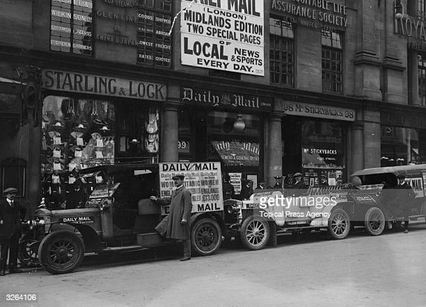 Drivers stand by Daily Mail motor cars in Birmingham outside the newspaper office poised for the morning delivery