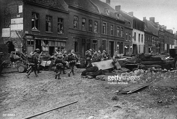 Bailleul an important town in the Lys sector of France fell to the Germans on April 15th 1918 Here the second wave of German troops advance through...