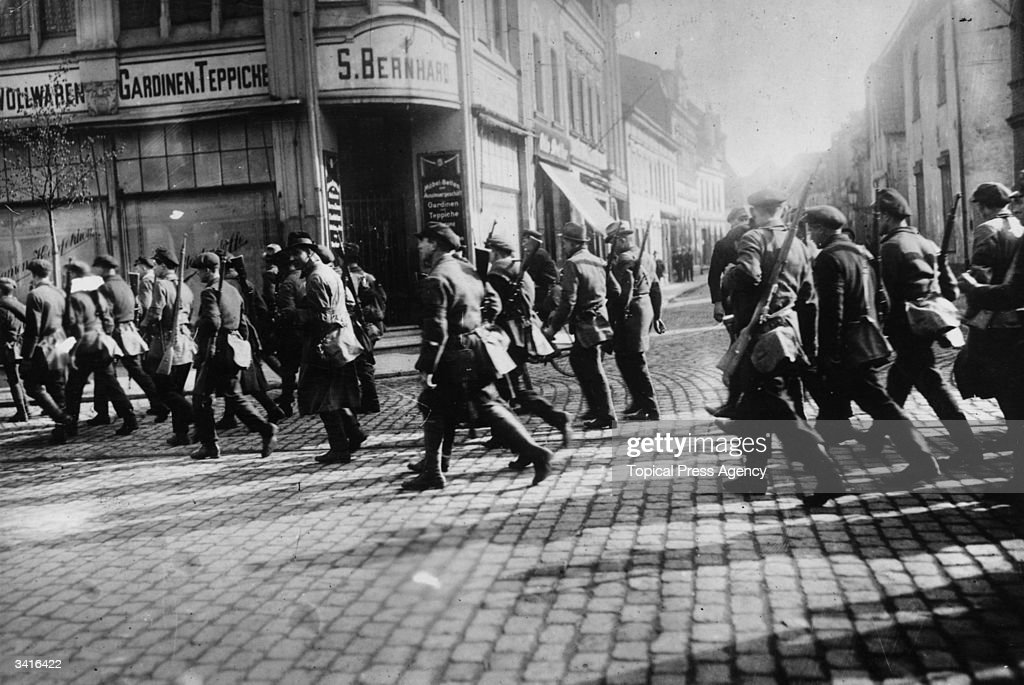 Communist supporters ('the Rote Ruhrarmee' or 'Ruhr Red Army') marching through the German town of Lohberg.