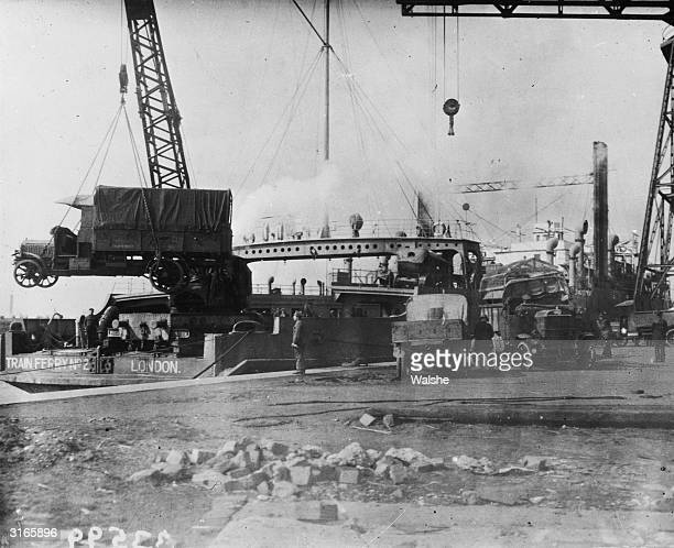 British military vehicles being hoisted onto the train ferry at the River Liffey Dublin during the evacuation of British troops from Ireland