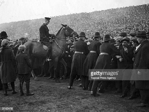 Mounted police controlling the crowds during the FA Cup SemiFinal match between Sheffield United and Bolton Wanderers at Old Trafford