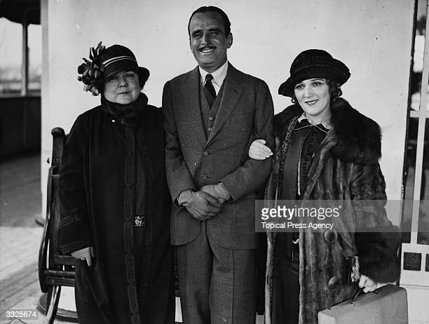 American actor Douglas Fairbanks Senior with his wife Mary Pickford and her mother on board the 'Olympic'