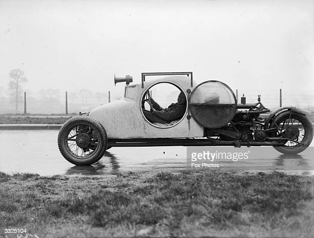 Three-wheeled car made by Mr A Graham of Kingston, Surrey. The vehicle, designed in a nautical style, reaches a maximum speed of 70 miles an hour...
