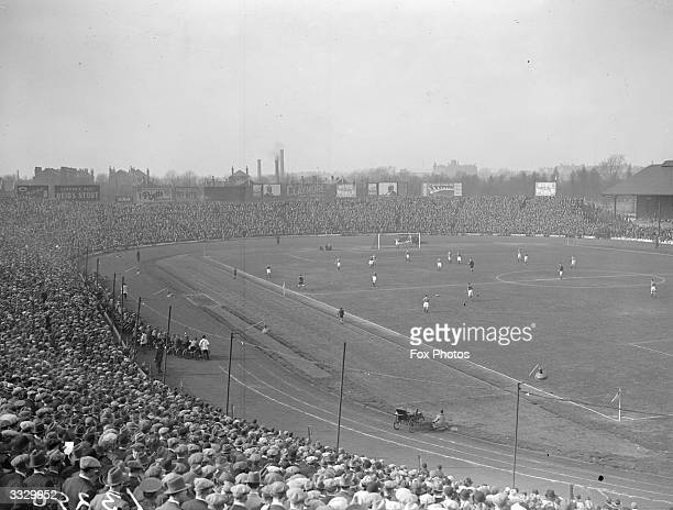 Crowd watching a game in progress at Chelsea football ground.