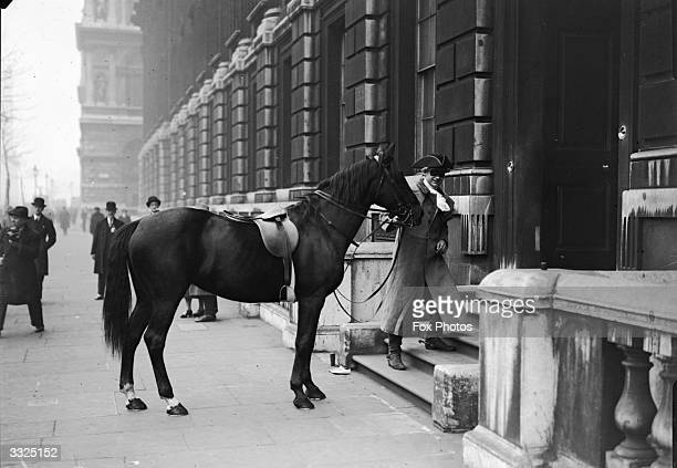 Film star Kenneth McLaglen calls in on Winston Churchill at the Treasury in costume for his role in the film 'Dick Turpin' and leading the horse...