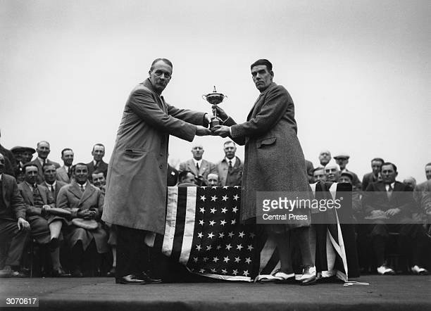 In Leeds, British golfer George Duncan captain of the British Ryder Cup team is presented with the cup by British businessman Samuel Ryder , founder...