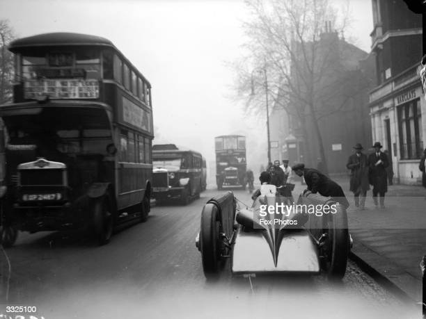 The Golden Arrow, a record breaking car, being taken through a street en route to Selfridges department store in London. Prior to this, Major Henry...