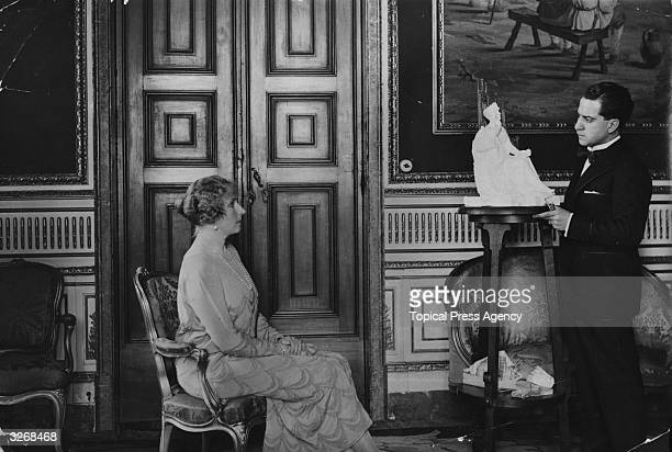 Queen Ena of Spain wife of Alfonso XIII posing for a sculptor