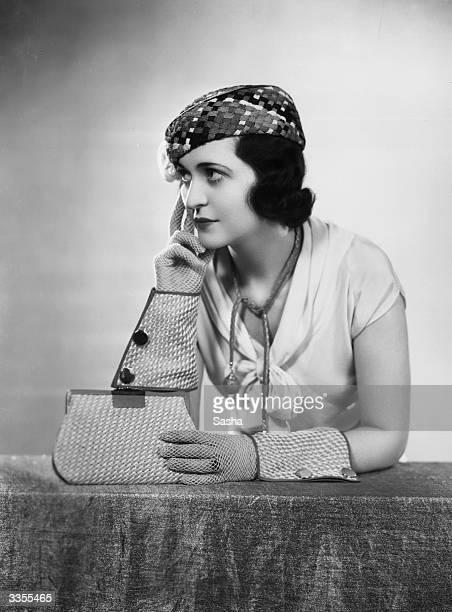 Mercia Swinburne wearing a Parisian collection of fashion accessories made in woven stranded silk and cotton In the collection are gloves handbag a...
