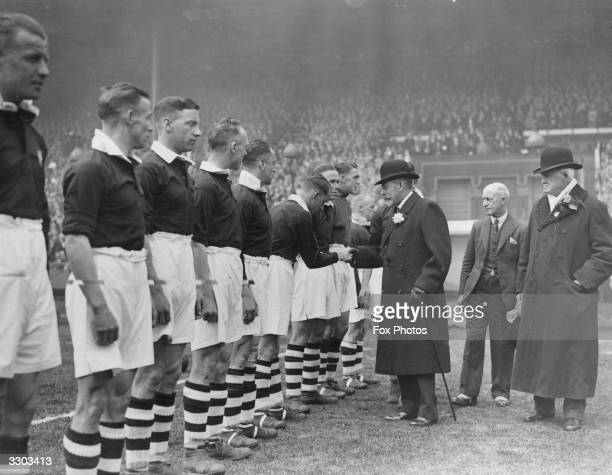 King George V shakes hands with members of Manchester City football team before the 1934 FA Cup Final at Wembley Manchester City went on to win the...