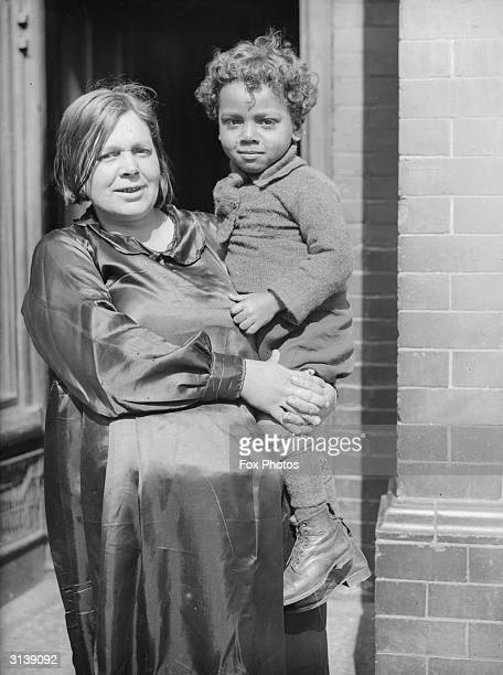 Holding her son in her arms, Mrs Johnson of Newport, South Wales.
