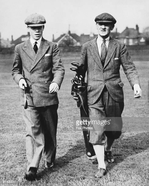 British golfer Abe Mitchell with his son Leonard on Veralum golf course near St Albans.