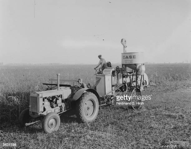 A farmer threshing wheat on an Illinois farm
