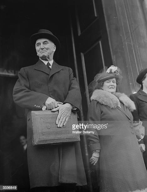 British Liberal politician and Chancellor of the Exchequer John Simon leaving the Treasury building in Whitehall with his budget