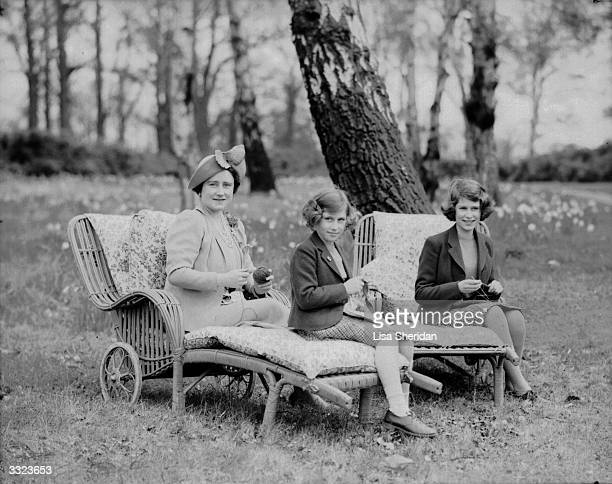 Queen Elizabeth Queen Consort to King George VI with her daughters Princess Margaret Rose and Princess Elizabeth in the grounds of the Royal Lodge...