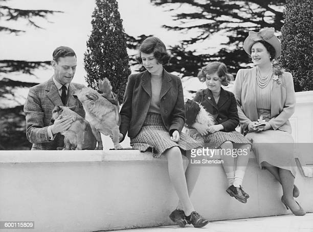 The Royal family at the Royal Lodge in Windsor Queen Elizabeth Princess Margaret Princess Elizabeth and King George VI with the family dogs Ching...