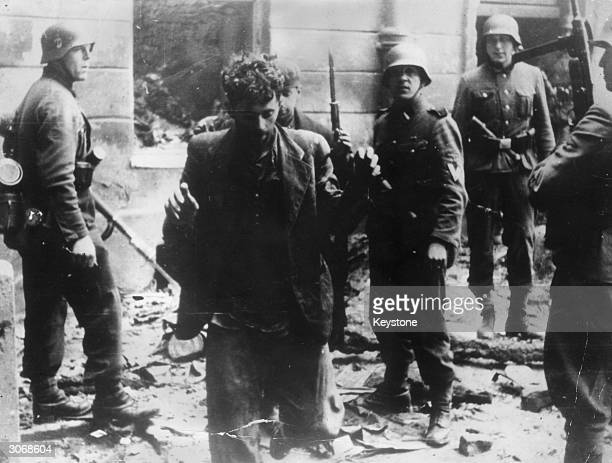 Two Jewish resistance fighters arrested by German troops during the Warsaw Ghetto Uprising