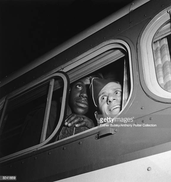 Two soldiers look out of a bus window in Washington DC.