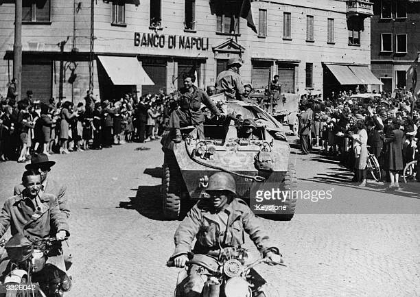 Crowds line the streets to greet US troops as they liberate Milan towards the end of the Second World War.